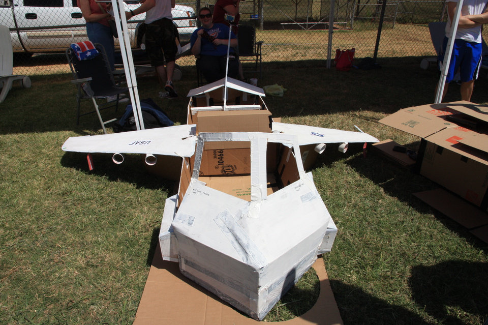 "A view of ""AWACS in a Box"" before it was put into the water at the Tinker Air Force Base pool Saturday afternoon. The cardbboard boat was the work of team ThunderCats for the 11th Annual Tinker Cardboard Boat Regatta.  Photo by Thomas Maupin"