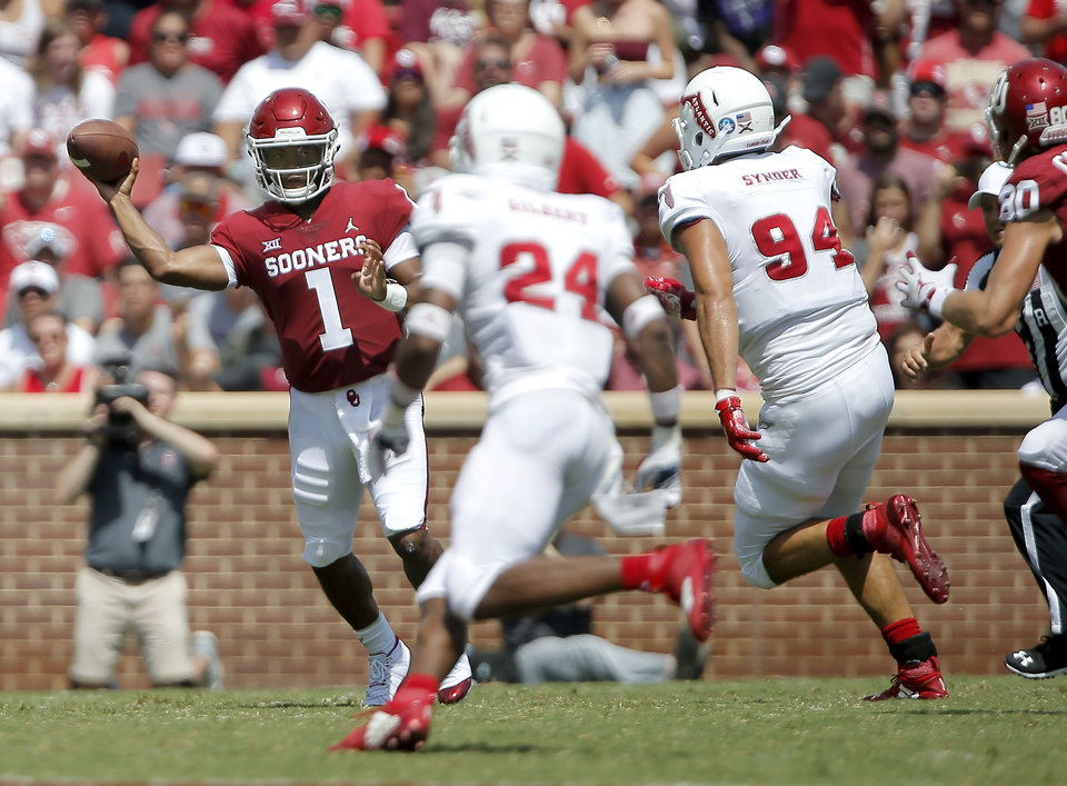 Photo -  Oklahoma's Kyler Murray gets off a pass in the face of the Florida Atlantic defense Saturday. The first-year OU starter went 9-for-11 passing for 209 yards with two touchdowns. [Photo by Bryan Terry, The Oklahoman]