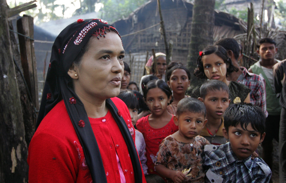 Photo - In this photo taken on Nov. 10, 2012, a Kaman Muslims talks to journalists at Sin Thet Maw relief camp in Pauk Taw township, Rakhine state, western Myanmar. Stranded beside their decrepit flotilla of wooden boats, on a muddy beach far from home, the Muslim refugees tell story after terrifying story of their exodus from a once-peaceful town on Myanmar's western coast. The Oct. 24 exodus was part of a wave of violence that has shaken western Myanmar twice in the last six months.  (AP Photo/Khin Maung Win)