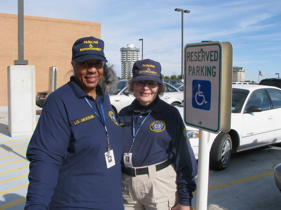 Photo - Handicap Parking Enforcement Specialist Officers Lois Jackson and Eleanor Curtis. BY VALLERY BROWN, THE OKLAHOMAN