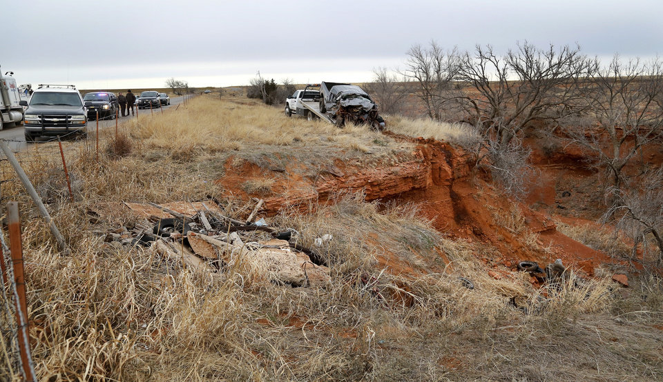 Photo - The wreckage of a 2011 Ford pickup truck is shown when it was pulled from a ravine where it landed after the driver ran off a two lane blacktop road east of Dill City.  This truck was driven by suspect Quentin Lee Johnson, 27 of Sentinel. Two officers died in a separate crash as they pursued this vehicle near Dill City. A Burns Flat police officer and an undersheriff for the Washita County Sheriff's Department died in a car crash on Thursday, Jan. 23, 2014, at a rural intersection about one mile south of Dill City.  According to OHP spokesman, the lawmen became involved in a high-speed pursuit  when a Washita County man fled as the undersheriff approached him to serve a felony warrant Thursday morning.  That same suspect died about the same time in another crash about three miles east of the location where the law officers collided. Dill City is located 75 miles west of Oklahoma City. Photo by Jim Beckel, The Oklahoman