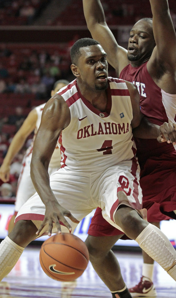 Photo - Oklahoma Sooners' Andrew Fitzgerald (4) tries to go around South Carolina State Bulldogs' Presano Bell (20) in the second half as the University of Oklahoma (OU) Sooners defeat the South Carolina State Bulldogs 83-48 in men's college basketball at the Lloyd Noble Center on Wednesday, Dec. 21, 2011, in Norman, Okla.  Photo by Steve Sisney, The Oklahoman