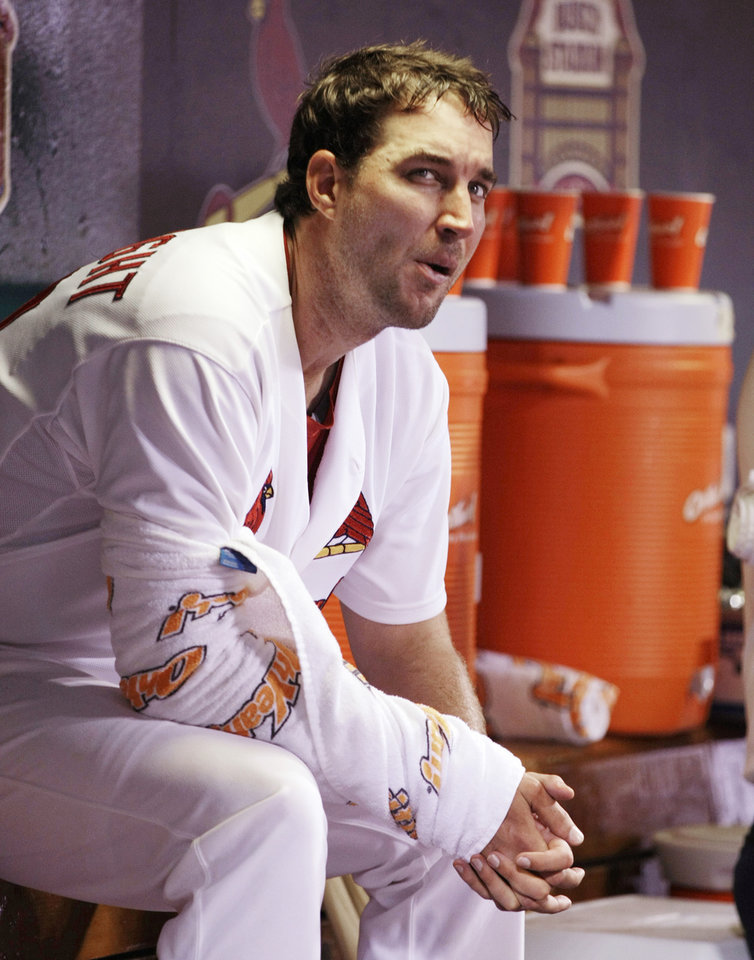 Photo - St. Louis Cardinals starting pitcher Adam Wainwright sits on the bench after finishing the seventh inning of a baseball game against the Pittsburgh Pirates, Monday, July 7, 2014, in St. Louis. Wainwright threw 112 pitches in seven innings of work, walking three but not giving up any runs. (AP Photo/Tom Gannam)
