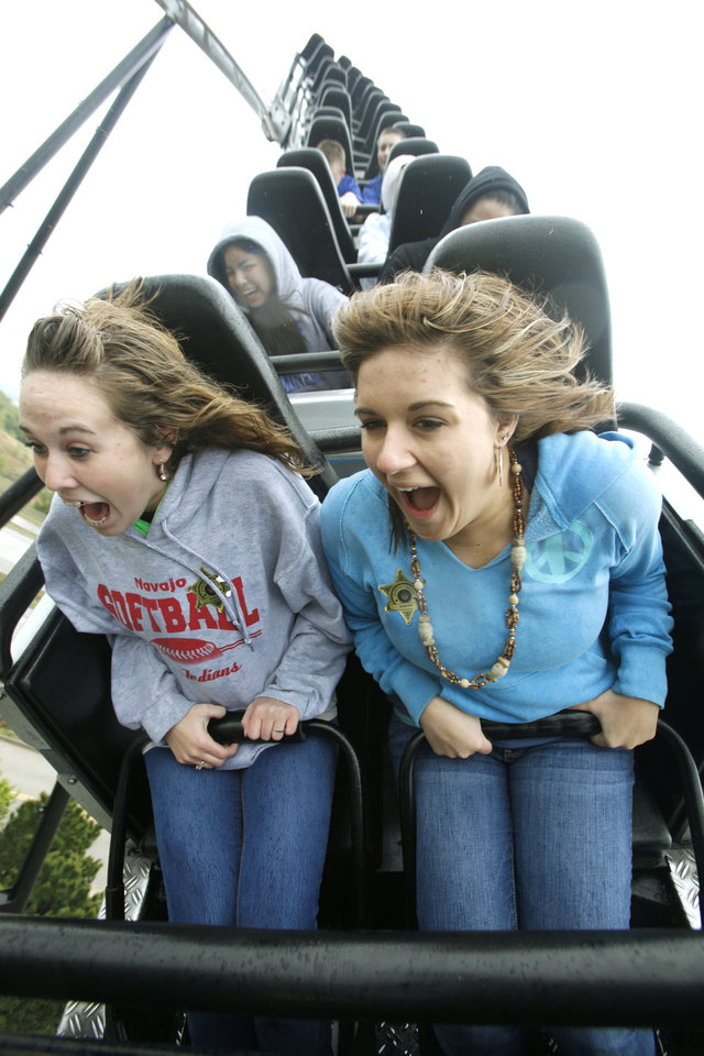 16-year-old Morgan Brian, left, and 17-year-old Bailey Staggs ride the Silver Bullet during the opening day at Frontier City in Oklahoma City, OK, Saturday, April 17, 2010. By Paul Hellstern, The Oklahoman