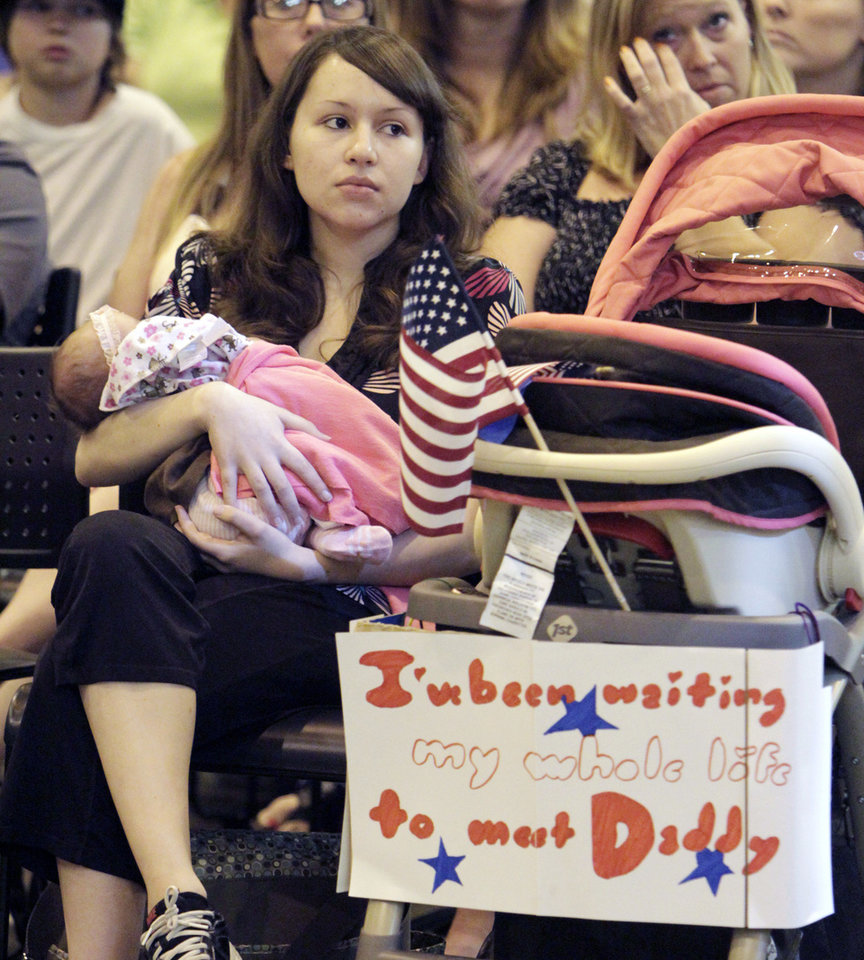 Three-week-old Kacey Ainesworth and her mom Stephanie wait for Spc. Dustin Ainesworth, as around 200 Oklahoma National Guard soldiers with the 180th Cavalry Squadron return to Oklahoma City, OK, from their deployment in Kuwait, Thursday, March 29, 2012,  By Paul Hellstern, The Oklahoman