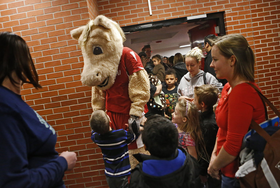 Photo - Oklahoma mascot Boomer greets children during a wellness fair at Jefferson Elementary School in Norman, Okla., Thursday, Jan. 24. 2013. Photo by Bryan Terry, The Oklahoman