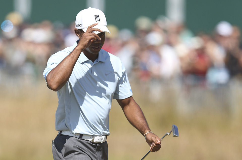 Photo - Tiger Woods of the United States acknowledges the crowd on the 18th green after his second round of the British Open Golf Championship at Muirfield, Scotland, Friday July 19, 2013. (AP Photo/Scott Heppell)