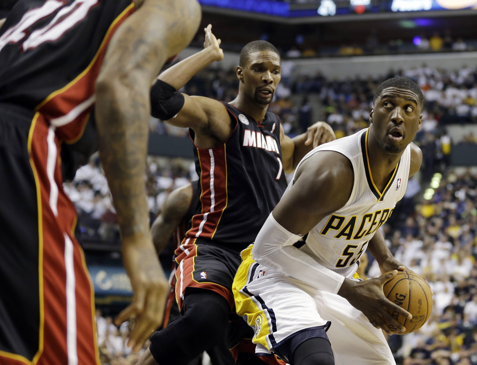 Indiana Pacers' Roy Hibbert (55) goes to the basket against Miami Heat's Chris Bosh (1) during the second half of Game 3 of the NBA Eastern Conference basketball finals in Indianapolis, Sunday, May 26, 2013. (AP Photo/Nam H. Huh)