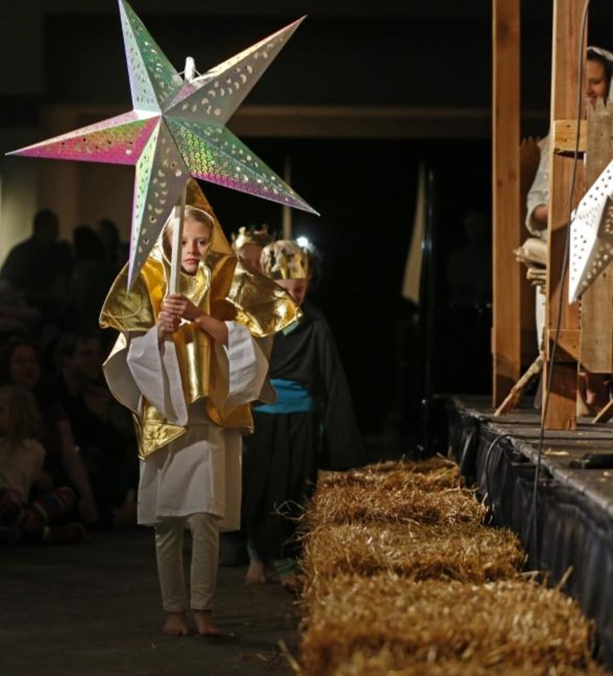 Photo -  In this 2015 photo, Hattie Bond portrays the Star of Bethlehem in a live Nativity play during