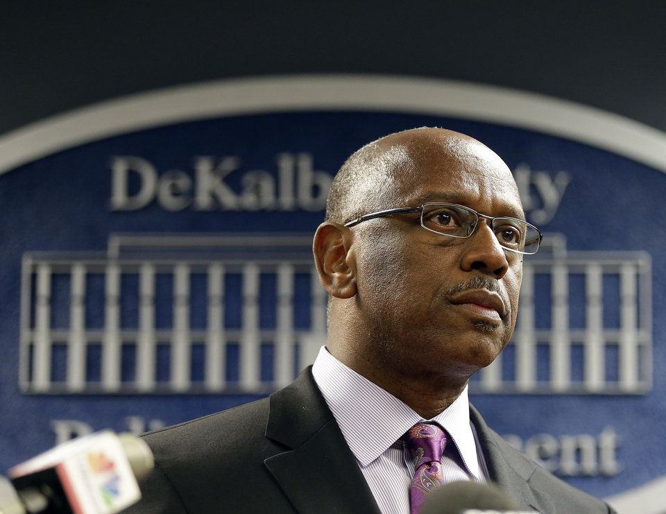Photo - DeKalb County Police Chief Cedric L. Alexander listens to a question during a news conference in Tucker, Ga., Wednesday, Aug. 21, 2013. Police say Michael Brandon Hill, arrested Tuesday at a Decatur, Ga., elementary school, had an AK 47-style rifle and almost 50 rounds of ammunition on him. (AP Photo/John Bazemore)
