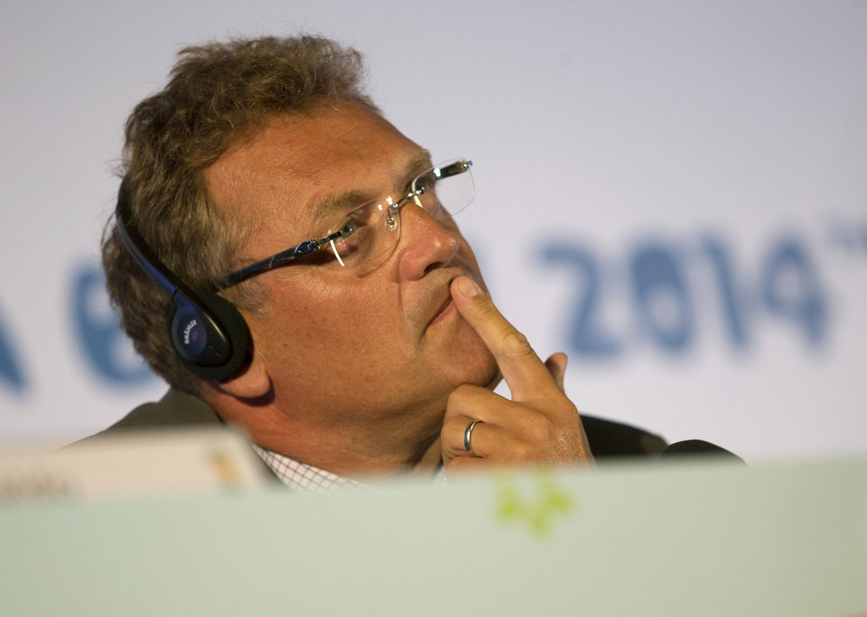 Photo - FIFA's secretary general Jerome Valcke listens to a question during a press conference in Rio de Janeiro, Brazil, Thursday, Aug. 22, 2013. FIFA's secretary general has floated an idea for a possible change to the World Cup bidding process in response to a spate of challenges in organizing next year's tournament in Brazil, which he says has
