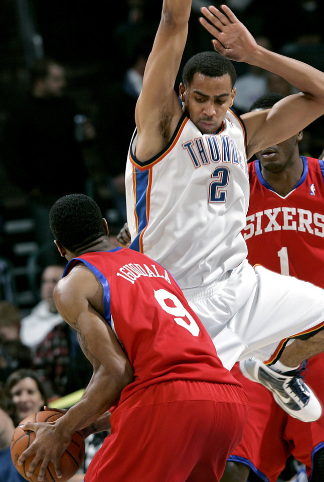 Oklahoma City's Thabo Sefolosha pressures Philadelphia's Andre Iguodala during the second half of their NBA basketball game at the Ford Center in Oklahoma City on Tuesday, Dec. 2, 2009. The Thunder beat the 76ers 117 to 106. By John Clanton, The Oklahoman