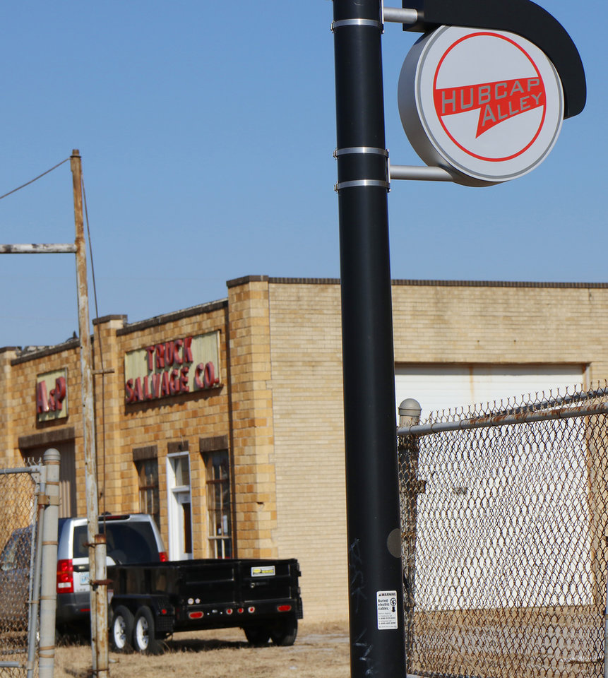 Photo -  Hub Cap Alley signs are still on display along the surviving east side of the street. [Photo by Doug Hoke, The Oklahoman]