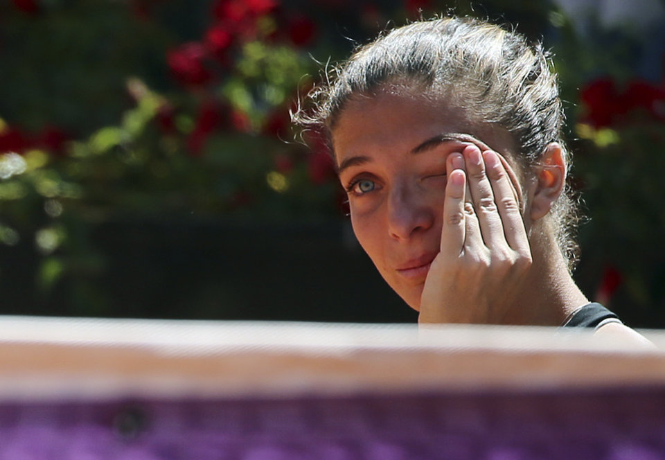 Photo - Italy's Sara Errani, wipes her tears at the end the final match against Serena Williams at the Italian open tennis tournament in Rome, Sunday, May 18, 2014. Serena Williams kept the crowd from being a factor in a 6-3, 6-0 victory over 10th-seeded Sara Errani to win the Italian Open for the third time Sunday. (AP Photo/Gregorio Borgia)