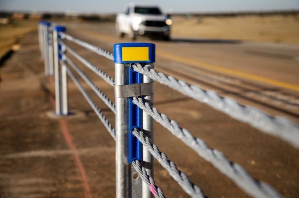 Photo -  Safety cables are in place to prevent crossover accidents on the Southwest Extension of the John Kilpatrick Turnpike. [Chris Landsberger/The Oklahoman]