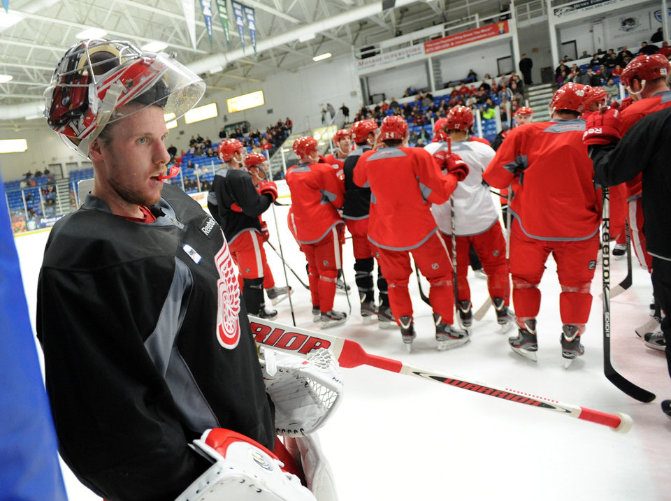 Detroit Red Wings goalie Jimmy Howard takes a breather between drills during the NHL hockey team's training camp Sunday, Jan. 13, 2013, in Plymouth, Mich. (AP Photo/The Detroit News, David Guralnick) DETROIT FREE PRESS OUT  HUFFINGTON POST OUT  MAGS OUT