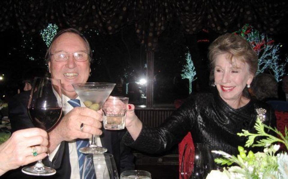 Photo - SPARKLE AND SHIMMER...A toast to the season was given by Bob and Ann Gilliland. (Photo by Helen Ford Wallace).