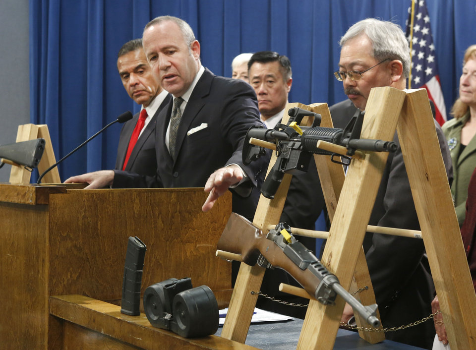 Photo - Senate President Pro Tem Darrell Steinberg, second from left,  glances to a pair of semi-automatic rifles as he discusses a package of proposed  gun control legislation at a Capitol news conference in Sacramento,  Calif., Thursday, Feb. 7, 2013.  Senate Democrats  unveiled a package of 10 proposed laws designed to close loopholes in existing gun regulations, keep firearms and ammunition out of the hands of dangerous person and strengthen education relating to firearms and gun ownership.  Also seen are Los Angeles Mayor Antonio Villaraigosa, left,   Sen. Leland Yee, D-San Francisco, third from left, San Francisco Mayor Ed Lee, second from right. (AP Photo/Rich Pedroncelli)