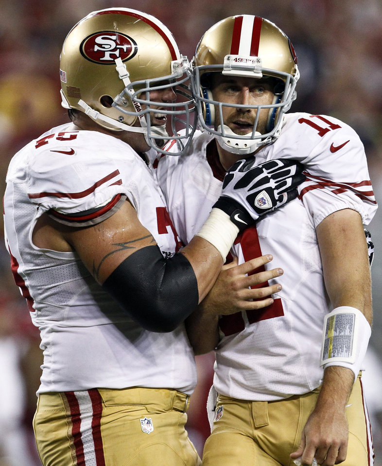 Photo -   San Francisco 49ers' Alex Smith (11) celebrates his second touchdown pass of the game against the Arizona Cardinals with Alex Boone, left, during the first half of an NFL football game, Monday, Oct. 29, 2012, in Glendale, Ariz. (AP Photo/Ross D. Franklin)
