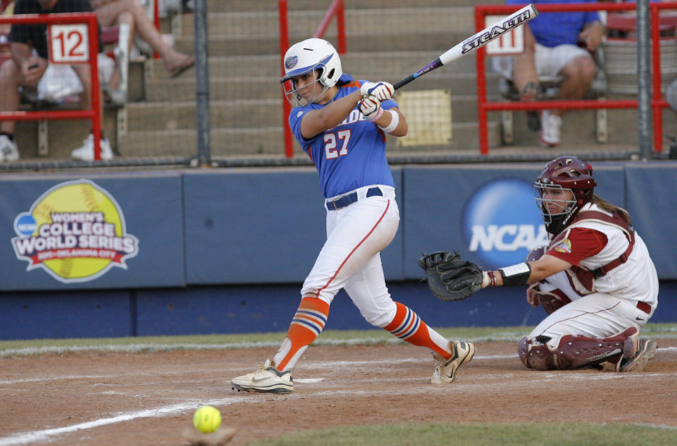 Photo - Florida's Cheyenne Coyle (27) hits a fowl ball during the Women's College World Series game between Alabama and Florida at the ASA Hall of Fame Stadium in Oklahoma City, Sunday, June 5, 2011. Photo by Garett Fisbeck, The Oklahoman