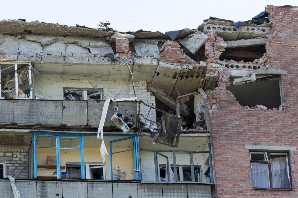 Photo - A damaged house is seen after shelling in the city of Kramatorsk, Donetsk region, eastern Ukraine, Thursday, July 3, 2014. Residential areas came under shelling on Thursday from government forces. (AP Photo/Dmitry Lovetsky)