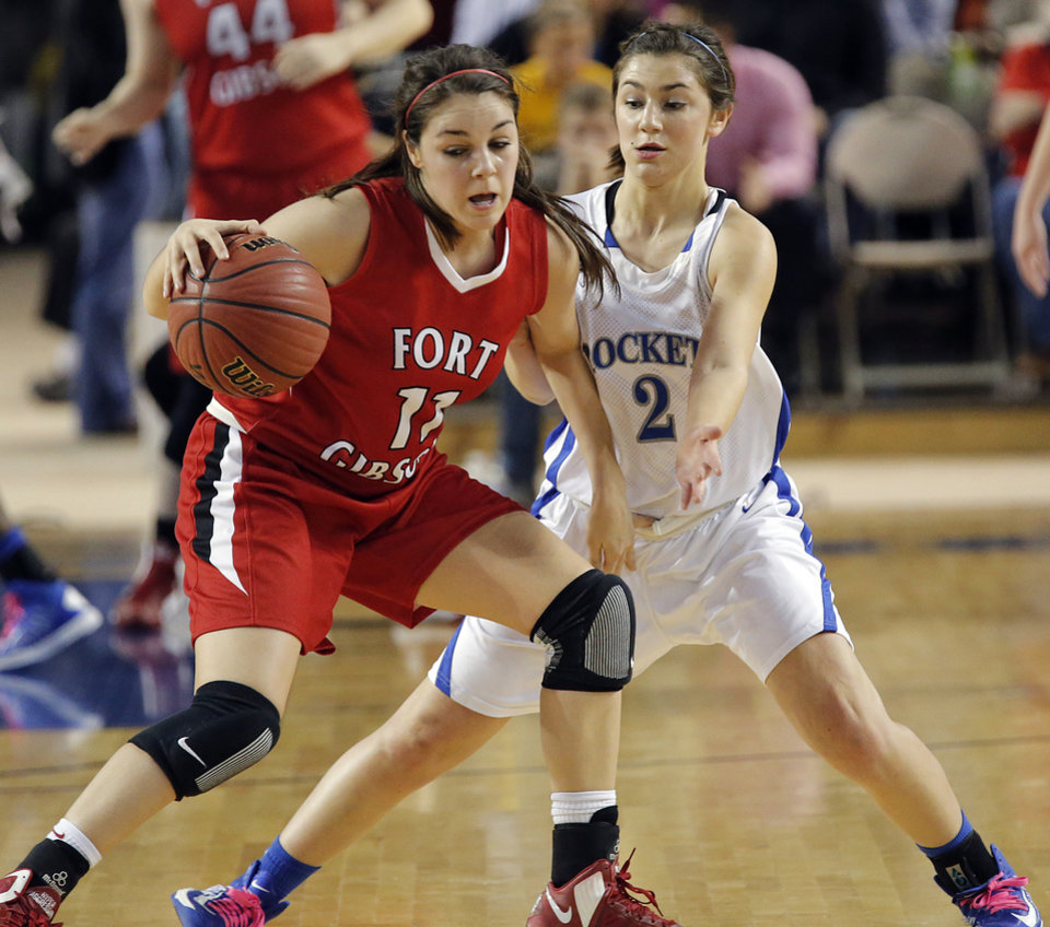 Mount Saint Mary's Aimee Rishcard (2) defends on Fort Gibson's Savannah Gray (11) during the state high school basketball tournament Class 4A girls championship game between Fort Gibson High School and Mount St. Mary High School at the State Fair Arena on Saturday, March 9, 2013, in Oklahoma City, Okla. Photo by Chris Landsberger, The Oklahoman