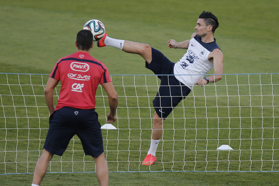 Photo - France's Remy Cabella plays tennis-ball during a training session at the Santa Cruz stadium in Ribeirao Preto, Brazil, Sunday, June 22, 2014. Having captured people's attention at the soccer World Cup with some scintillating attacking football, France's players are now in unknown territory after raising expectations back home, having routed Switzerland and Honduras. (AP Photo/David Vincent)