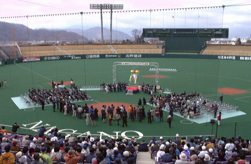 Photo - In this April 16, 2000 photo, a ceremony is held to unveil a baseball stadium, also known as the Olympic Stadium, which was used for the opening and closing ceremony for the 1998 Nagano Winter Olympics, in Nagano, central Japan. In Nagano, a city with a population of just 387,000, five large structures were built for the 1998 Winter Games. They remain in use, though many complain that the venues are too big and costly to maintain for the size of the town. (AP Photo/Kyodo News) JAPAN OUT.