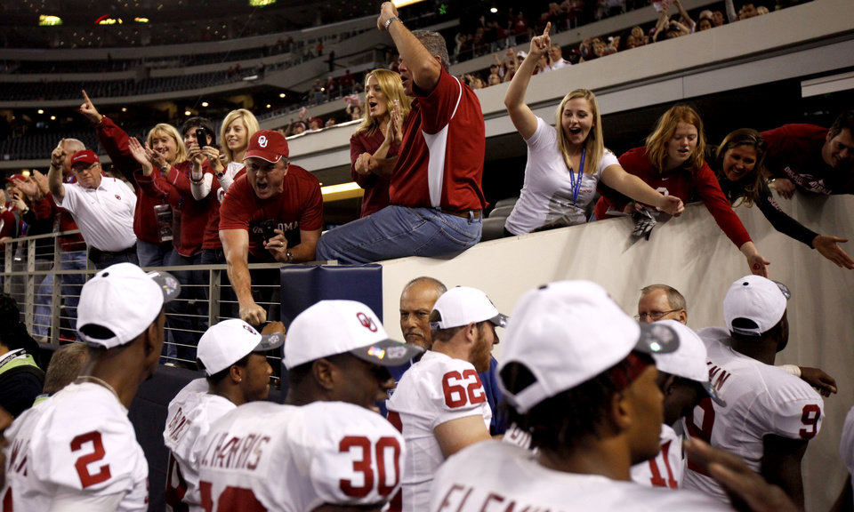 Fans celebrate with team after OU won  the Big 12 football championship game between the University of Oklahoma Sooners (OU) and the University of Nebraska Cornhuskers (NU) at Cowboys Stadium on Saturday, Dec. 4, 2010, in Arlington, Texas.  Photo by Bryan Terry, The Oklahoman