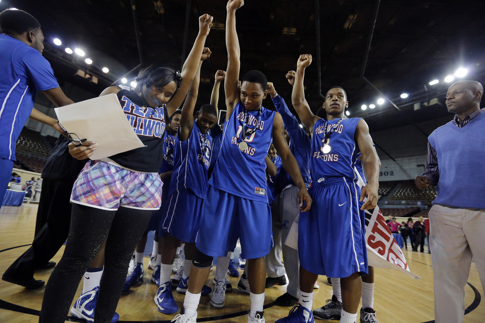 Millwood celebrates the win over Okemah during the state high school basketball tournament Class 3A boys championship game between Millwood High School and Okemah High School at the State Fair Arena on Saturday, March 9, 2013, in Oklahoma City, Okla. Photo by Chris Landsberger, The Oklahoman