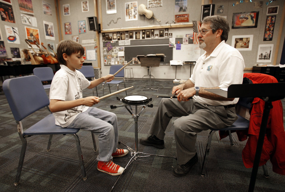 David Davisson, Norman North band director, works with Chris Maennena, John Adams Elementary School, on the drums as students check out which instrument they would like to play at a Band Fair at Whittier Middle School on Saturday, May 12, 2012, in Norman, Okla.   Photo by Steve Sisney, The Oklahoman
