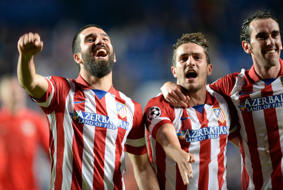 Photo - Atletico Madrid's Arda Turan, left, Koke, center, and Diego Godin celebrate after the Champions League semifinal second leg soccer match between Chelsea and Atletico Madrid at Stamford Bridge Stadium in London, Wednesday, April 30, 2014. (AP Photo/Andrew Matthews, PA Wire)    UNITED KINGDOM OUT   -   NO SALES   -  NO ARCHIVES