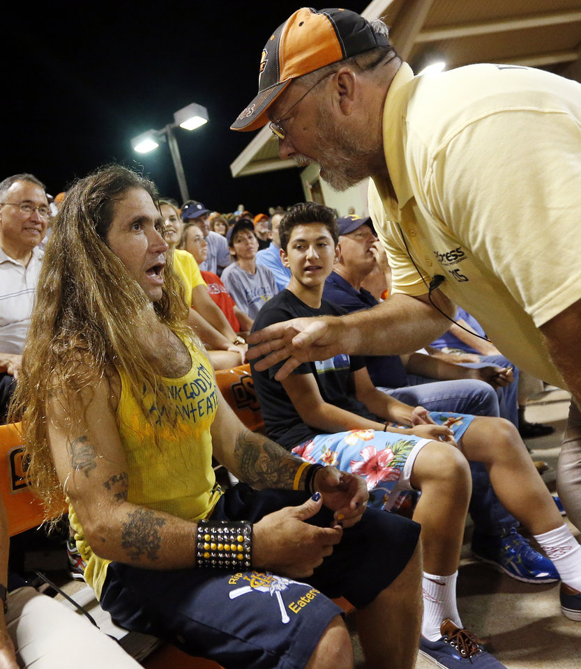 Photo - An usher warns UC Irvine super fan Keith Franklin about getting out of his seat during Game 1 of the NCAA baseball Stillwater Super Regional between Oklahoma State and UC Irvine at Allie P. Reynolds Stadium in Stillwater, Okla., Friday, June 6, 2014. Photo by Nate Billings, The Oklahoman