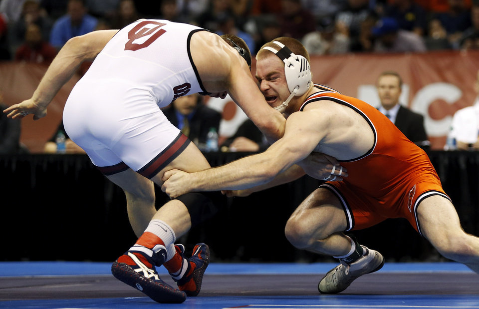 OSU's Chris Perry wrestles OU's Andrew Howe during the 174-pound championship match in the 2014 NCAA Div. I Wrestling Championships at Chesapeake Energy Arena in Oklahoma City, Saturday, March 22, 2014. Photo by Nate Billings, The Oklahoman
