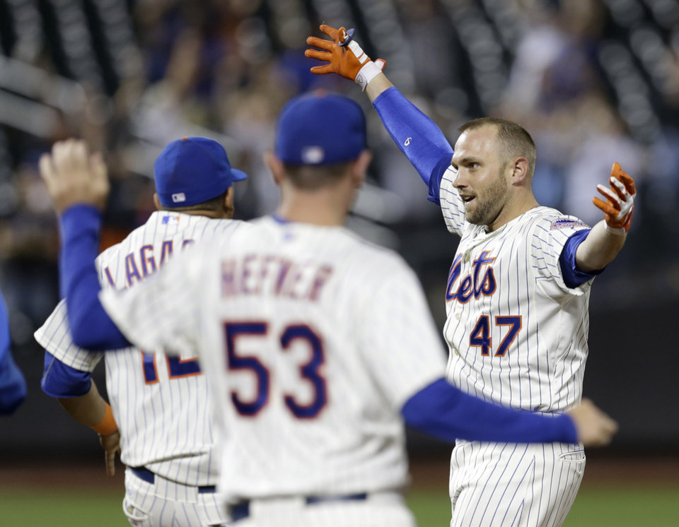 Photo - New York Mets' Andrew Brown celebrates his game winning single during the 13th inning of the baseball game against the Arizona Diamondbacks at Citi Field, Tuesday, July 2, 2013, in New York. The Mets beat the Diamondbacks 5-4. (AP Photo/Seth Wenig)