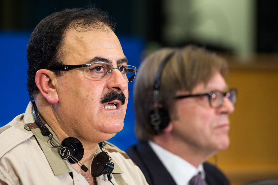 Photo - FILE - In this Wednesday March 6, 2013 file photo, Chief of Staff of the Free Syrian Army Gen. Salim Idris addresses the media after he discussed the situation in Syria with the leader of the Group of the Alliance of Liberals and Democrats for Europe Guy Verhofstadt, right, at the European Parliament in Brussels. Idris marked the second anniversary of the start of the uprising against President Bashar Assad on Friday, March 15, 2013, by pledging to fight until the