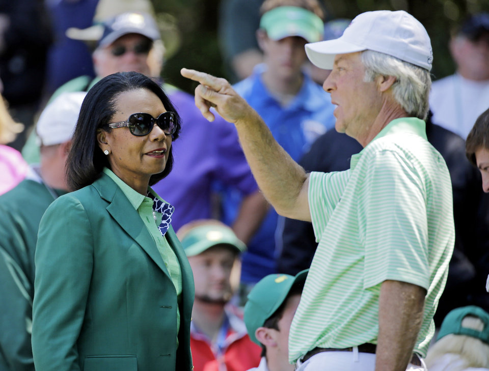 Photo - Former U.S. Secretary of State Condoleezza Rice speaks with Ben Crenshaw during the par three competition at the Masters golf tournament Wednesday, April 9, 2014, in Augusta, Ga. (AP Photo/David J. Phillip)