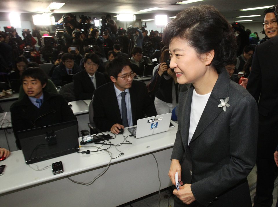 South Korea's president-elected Park Geun-hye leaves after a press conference at the headquarters of Saenuri Party in Seoul, South Korea, Thursday, Dec. 20, 2012. Park was elected South Korean president Wednesday, becoming the country's first female leader despite the incumbent's unpopularity and her own past as the daughter of a divisive dictator. (AP Photo/Ahn Young-joon)