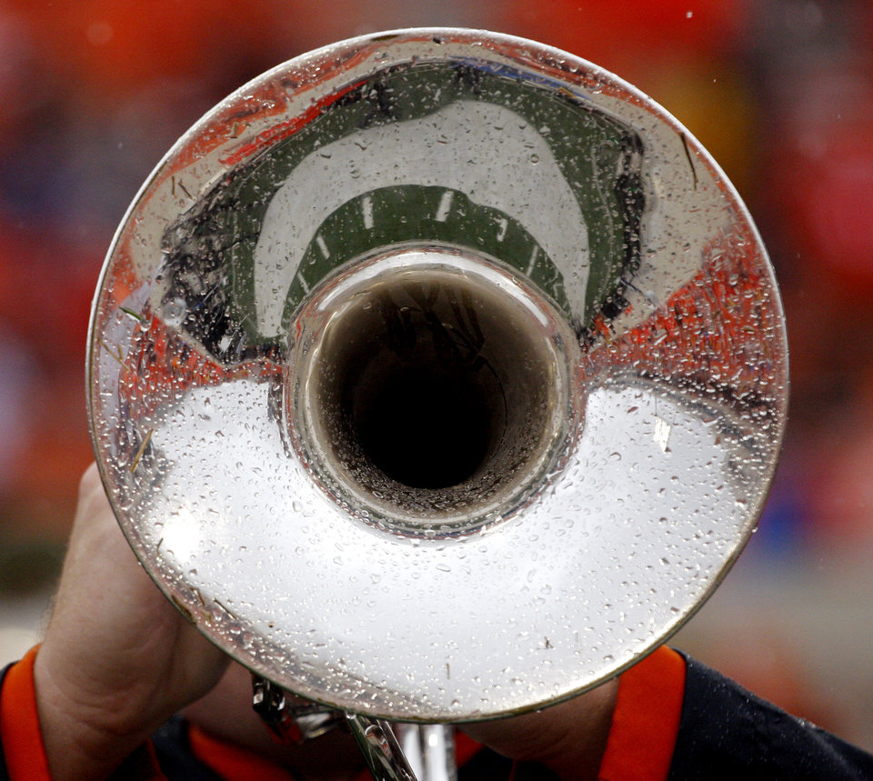 Photo - A wet horn during pregame band performance at the Oklahoma State University (OSU) football game against Missouri State University (MSU) Saturday Sept. 13, 2008 at Boone Pickens Stadium in Stillwater, Okla. BY DOUG HOKE, THE OKLAHOMAN.