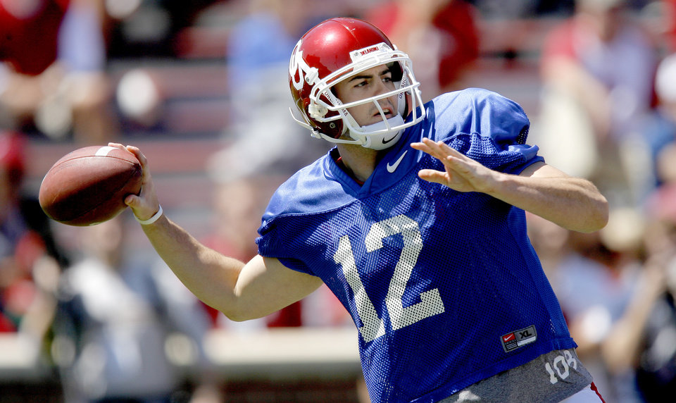 Photo - OU's Landry Jones throws the ball during Oklahoma's Red-White football game at The Gaylord Family - Oklahoma Memorial Stadiumin Norman, Okla., Saturday, April 11, 2009. Photo by Bryan Terry, The Oklahoman