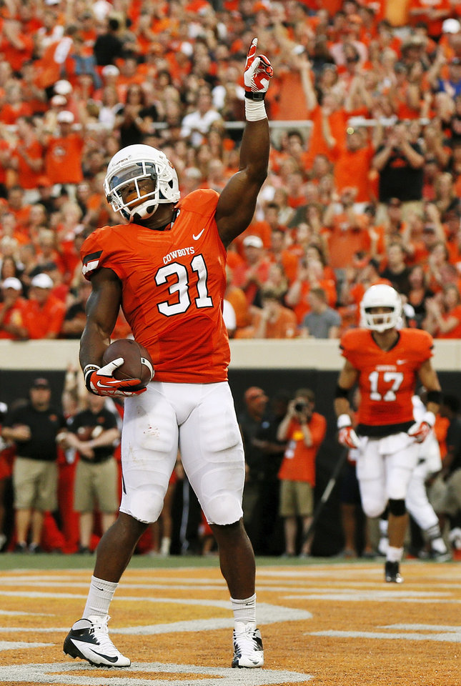 Photo - Oklahoma State's Jeremy Smith (31) celebrates a touchdown run in the first quarter near Charlie Moore (17) during a college football game between the Oklahoma State University Cowboys (OSU) and the Lamar University Cardinals at Boone Pickens Stadium in Stillwater, Okla., Saturday, Sept. 14, 2013. Photo by Nate Billings, The Oklahoman