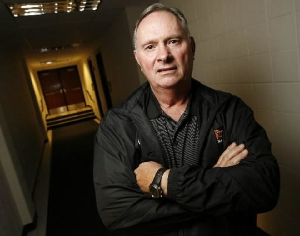 New OSU college football defensive coordinator  Bill  Young poses for a photo in a hall inside Gallagher-Iba Arena on the campus of Oklahoma State University in Stillwater, Okla., Friday, January 23, 2009. By Nate Billings