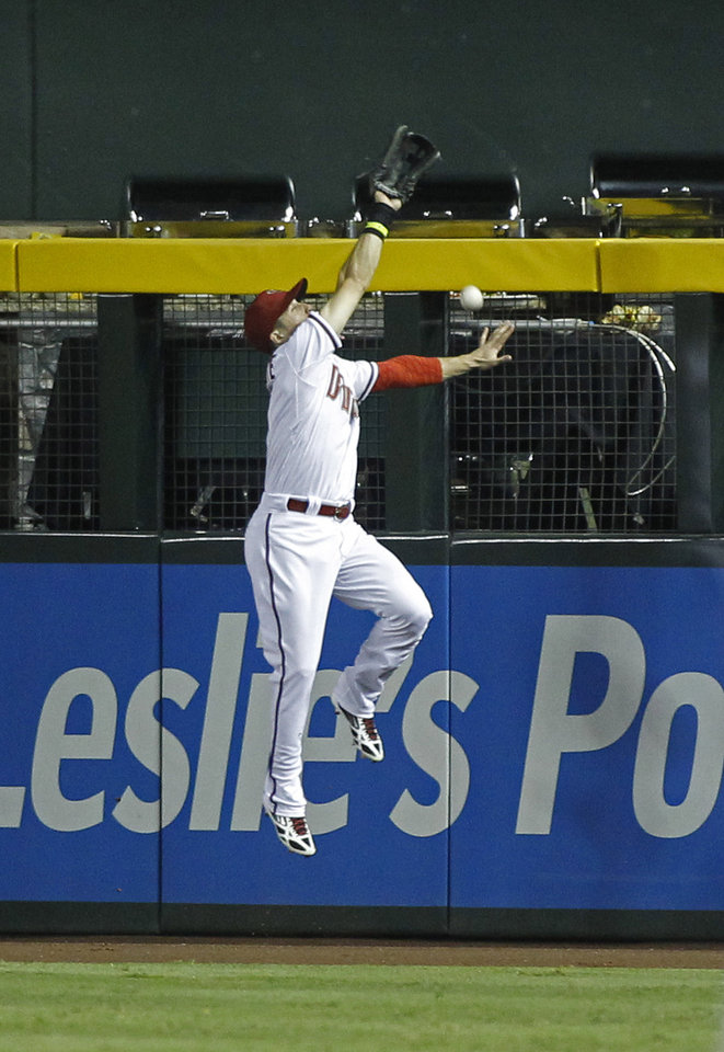 Photo - Arizona Diamondbacks center fielder Ender Inciarte can't make the catch of a deep fly ball off the wall by Pittsburgh Pirates' Josh Harrison during the eighth inning of a baseball game, Friday, August 1, 2014, in Phoenix. Harrison would end up with a triple on the play. (AP Photo/ Ralph Freso)