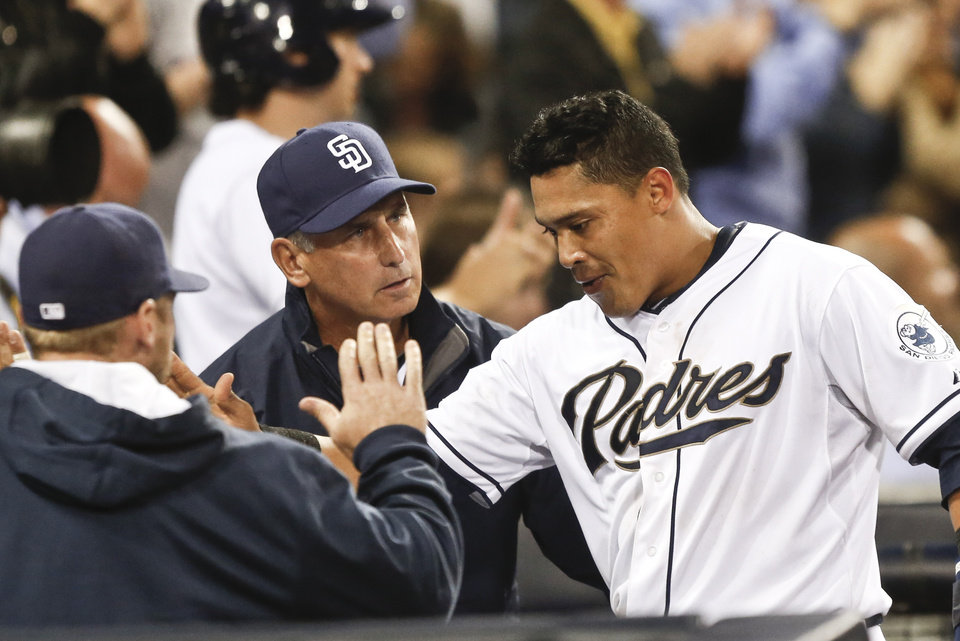 Photo - San Diego Padres' Everth Cabrera, right, gets the good word from San Diego Padres manager Bud Black after scoring against the Colorado Rockies in the fifth inning of a baseball game Wednesday, April 16, 2014, in San Diego.  (AP Photo/Lenny Ignelzi)