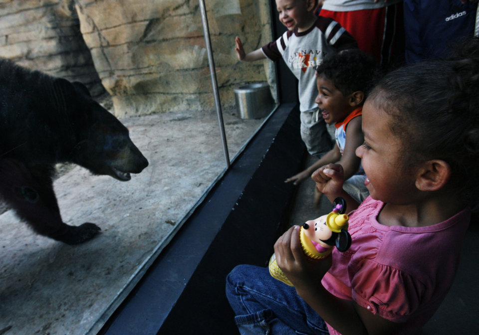 Photo - Right to left, Kitrell Hill, Anthony Morgan and Ethan Landis react to an American black bear at the Oklahoma City Zoo's new Oklahoma Trails exhibit in Oklahoma City, Okla., Saturday, March 10, 2007. By James Plumlee, The Oklahoman ORG XMIT: kod