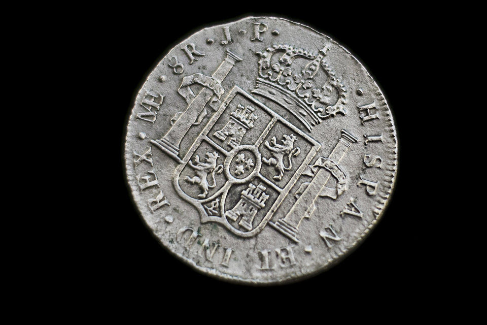 Photo - A silver coin from the shipwreck of a 1804 galleon, on its first display to the media at a ministry building, in Madrid, Friday, Nov. 30, 2012. Spanish cultural officials have allowed the first peep at 16 tons (14.5 metric tons) of the shipwreck, 'Nuestra Senora de las Mercedes' a treasure worth an estimated $500 million that a U.S. salvage company gave up after a five-year international ownership dispute. (AP Photo/Daniel Ochoa de Olza)