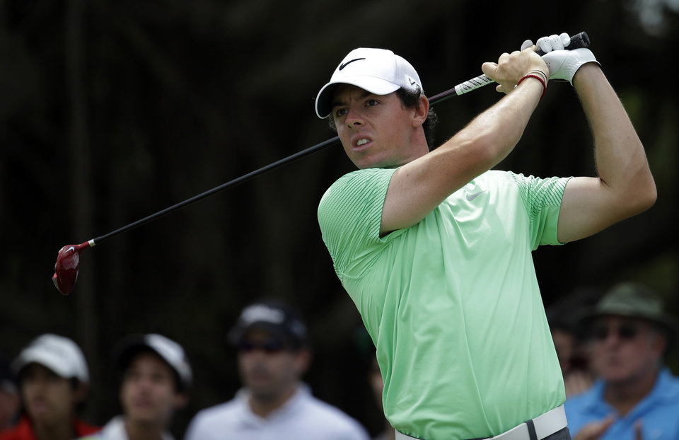 Photo - FILE - This is a Sunday, March 9, 2014, file photo of Rory McIlroy of Northern Ireland  as he tees off on the fourth hole during the final round of the Cadillac Championship golf tournament in Doral, Fla.  Rory McIlroy has decided to play for Ireland, not Britain, at the 2016 Olympics in Rio de Janeiro. The 25-year-old McIlroy, who is from Northern Ireland, was eligible to play for Britain or Ireland and had been wrangling over a decision for more than a year. The two-time major winner says Wednesday June 18, 2014,