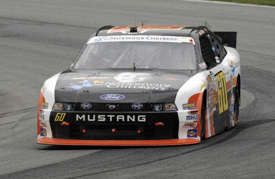 Photo - Chris Buescher drives through a corner during the NASCAR Nationwide Series Nationwide Children's Hospital 200 auto race at Mid-Ohio Sports Car Course Saturday, Aug. 16, 2014, in Lexington, Ohio. (AP Photo/Tom E. Puskar)