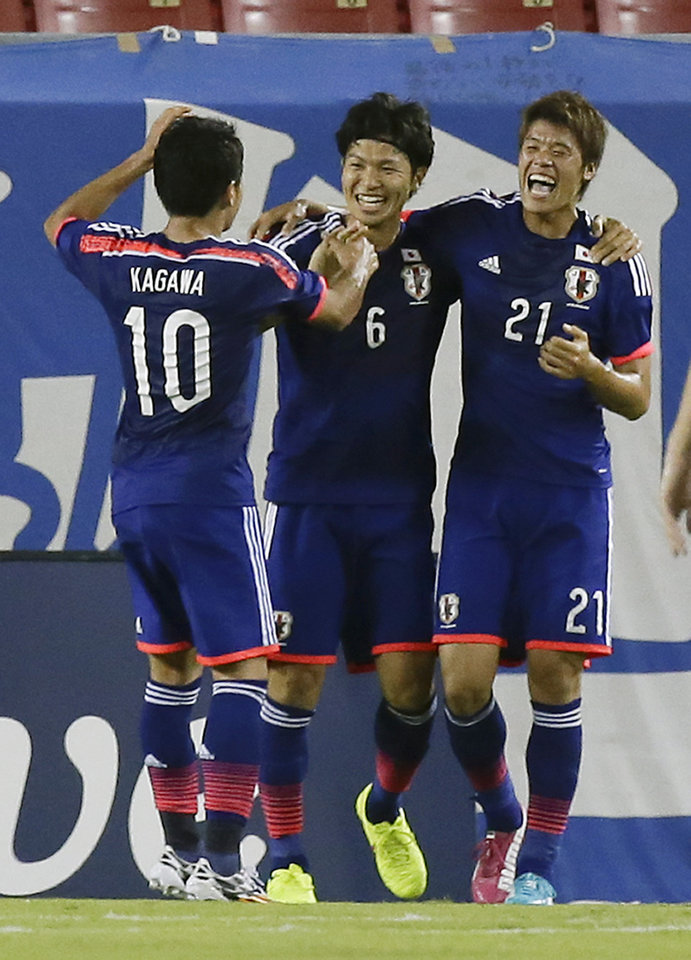 Photo - Japan's Shinji Kagawa (10) celebrates after scoring a goal against Zambia with teammates Masato Morishige (6) and Hiroki Sakai (21) during the second half of an international friendly soccer match in Tampa, Fla., Friday, June 6, 2014. Japan won 4-3. (AP Photo/John Raoux)