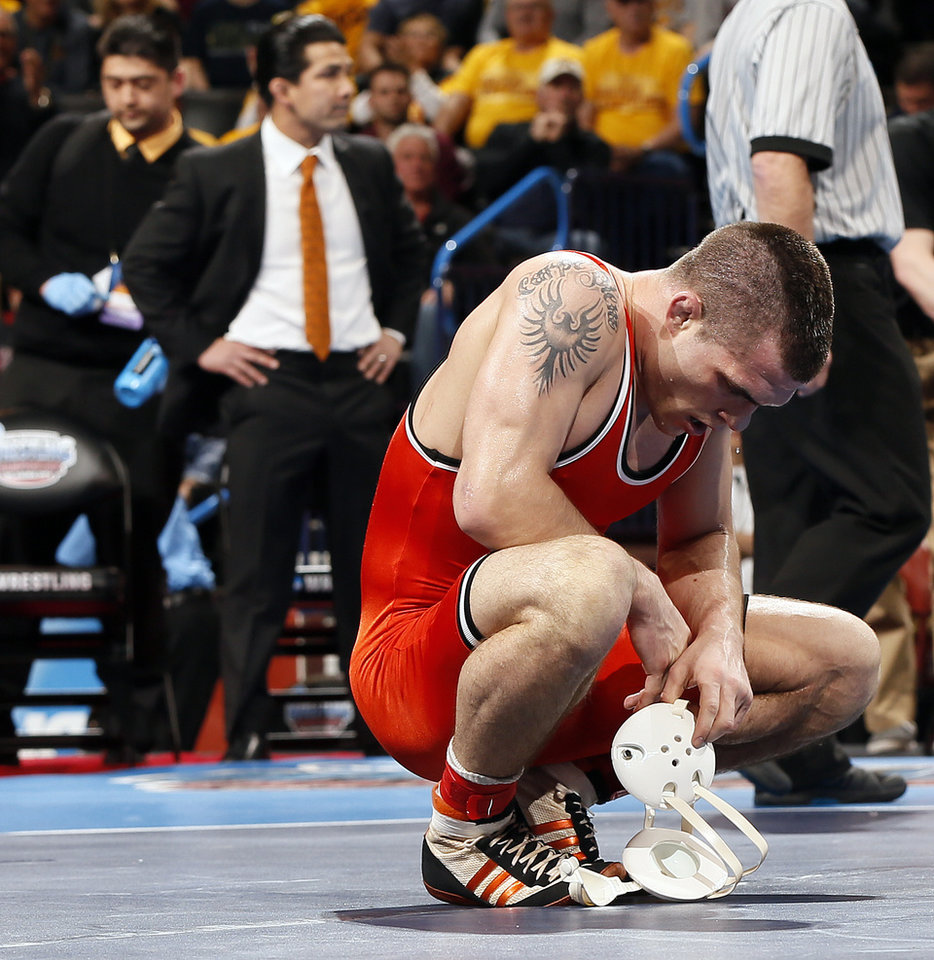 Photo - OSU's Joshua Kindig reacts after losing the 149-pound championship to Northwestern's Jason Tsirtsis, not pictured, in the 2014 NCAA Div. I Wrestling Championships at Chesapeake Energy Arena in Oklahoma City, Saturday, March 22, 2014. Photo by Nate Billings, The Oklahoman